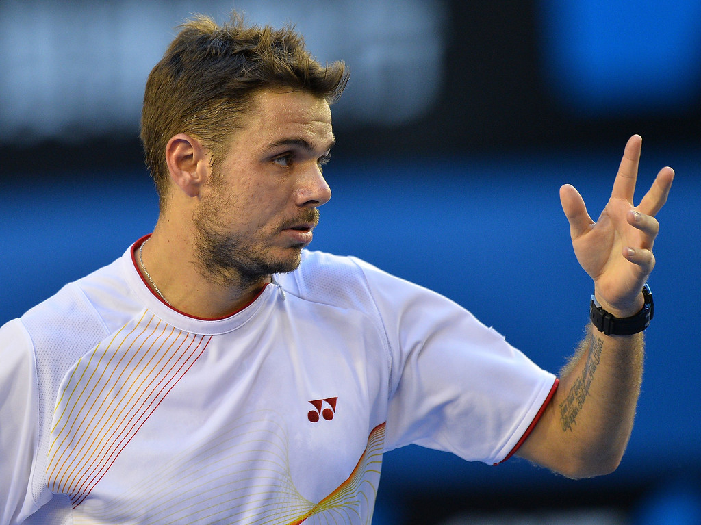 . Switzerland\'s Stanislas Wawrinka reacts after a point against Spain\'s Rafael Nadal during the men\'s singles final on day 14 of the 2014 Australian Open tennis tournament in Melbourne on January 26, 2014.  SAEED KHAN/AFP/Getty Images
