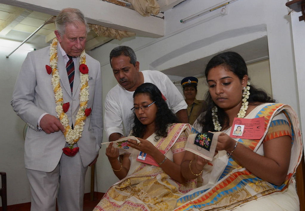 . In this handout photograph released by The Kerala Press and Information Department on November 14, 2013, Britain\'s Prince Charles (L) looks at a handicrafts demonstration during a visit to The Mattancherry Dutch Palace Museum in Kochi on November 14, 2013.    KERALA PRESS INFORMATION DEPARTMENT/AFP/Getty Images