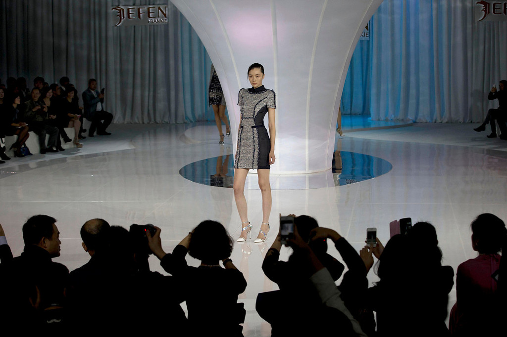 . A model presents a creation from the JEFEN collection by Chinese designer Frankie Xie during a Fashion Week in Beijing, China, Saturday, Oct. 26, 2013. (AP Photo/Ng Han Guan)