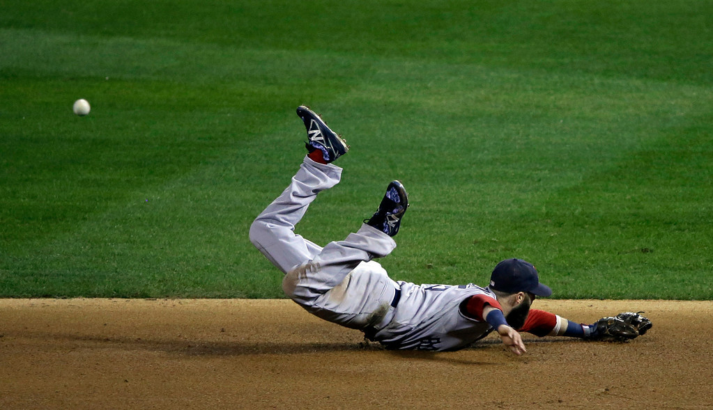 . Boston Red Sox\'s Dustin Pedroia dives for a ball hit by St. Louis Cardinals\' Kolten Wong during the eighth inning of Game 3 of baseball\'s World Series Saturday, Oct. 26, 2013, in St. Louis. (AP Photo/Charlie Neibergall)