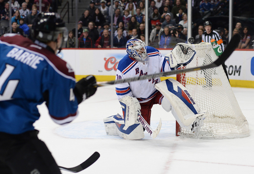 . Tyson Barrie took a shot on New York goaltender Henrik Lundqvist late in the third period.   (Photo by Karl Gehring/The Denver Post)