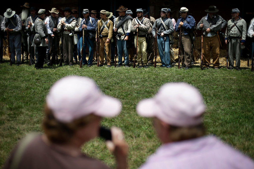 . Spectators view a demonstration of a Confederate field hospital by Floridians portraying the 1st N.C. Infantry during ongoing activities commemorating the 150th anniversary of the Battle of Gettysburg, Friday, June 28, 2013, at the Daniel Lady Farm in Gettysburg, Pa.  Union forces turned away a Confederate advance in the pivotal battle of the Civil War fought July 1-3, 1863, which was also the warís bloodiest conflict with more than 51,000 casualties. (AP Photo/Matt Rourke)