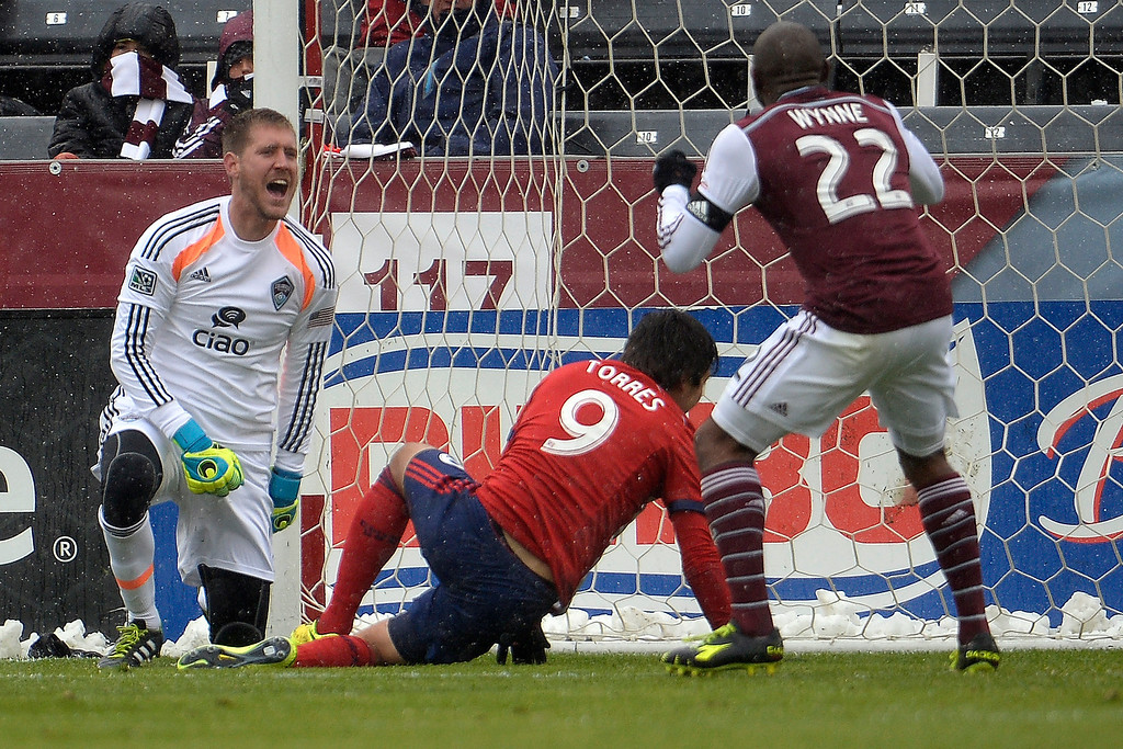 . Clint Irwin (1) of Colorado Rapids and Marvell Wynne (22) react to a 1-0 goal by Erick Torres (9) of Chivas USA during the second half. Chivas USA defeated the Colorado Rapids 3-1 on Sunday, May 11, 2014. (Photo by AAron Ontiveroz/The Denver Post)