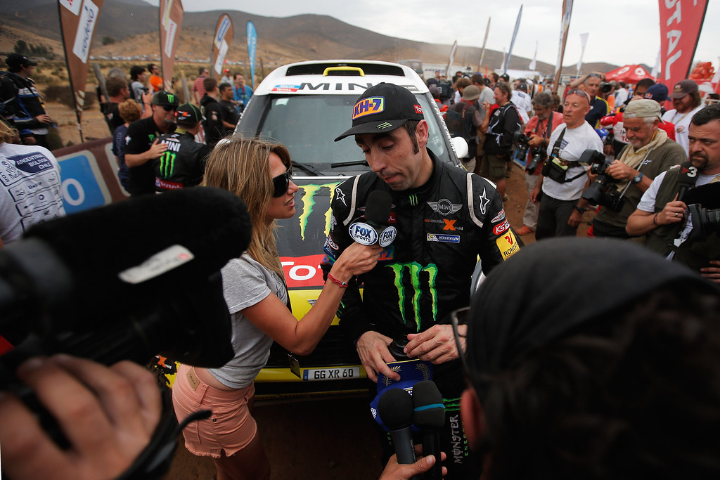 . ILLAPEL, CHILE - JANUARY 18:  (#304)  Nani Roma of Spain for MINI and the Monster Energy X-Raid Team speaks to the media on the finish line after winning the 2014 Dakar Rally on January 18, 2014 in Illapel, Chile.  (Photo by Dean Mouhtaropoulos/Getty Images)