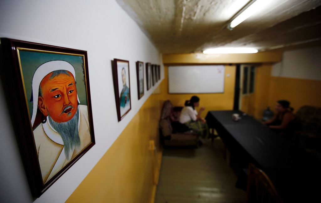 . A painting of Mongolian national hero Genghis Khan hangs in the headquarters of the Mongolian neo-Nazi group Tsagaan Khass in Ulan Bator June 22, 2013. The group has rebranded itself as an environmentalist organisation fighting pollution by foreign-owned mines, seeking legitimacy as it sends Swastika-wearing members to check mining permits.  Over the past years, ultra-nationalist groups have expanded in the country and among those garnering attention is Tsagaan Khass, which has recently shifted its focus from activities such as attacks on women it accuses of consorting with foreign men to environmental issues, with the stated goal of protecting Mongolia from foreign mining interests. This ultra-nationalist group was founded in the 1990s and currently has 100-plus members. Picture taken June 22, 2013. REUTERS/Carlos Barria