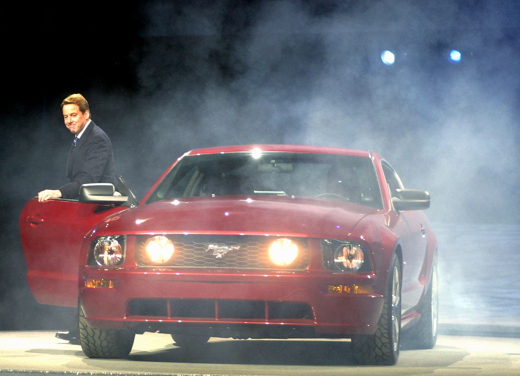 . Ford Motor Company Chairman Bill Ford Jr. climbs out of the new 2005 Ford Mustang sports car at the North American International Auto Show January 4, 2004 in Detroit, Michigan.  (Photo by Bill Pugliano/Getty Images)