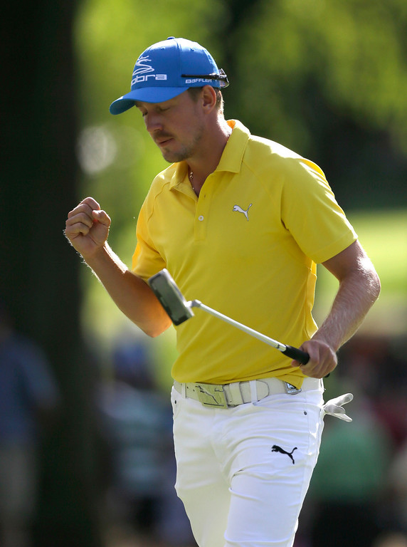 . Jonas Blixt, of Sweden, celebrates after a birdie on the 10th hole during the final round of the PGA Championship golf tournament at Oak Hill Country Club, Sunday, Aug. 11, 2013, in Pittsford, N.Y. (AP Photo/Julio Cortez)