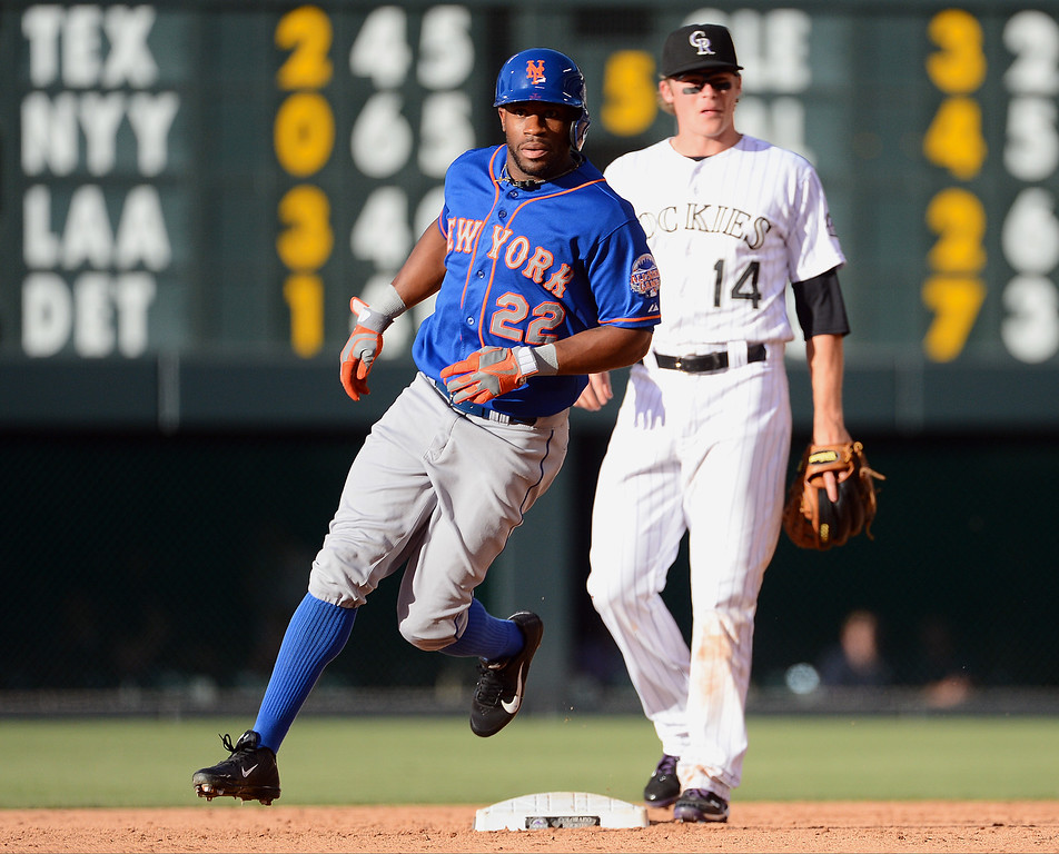 . Eric Young #22 of the New York Mets rounds second base during the game against the Colorado Rockies at Coors Field on June 27, 2013 in Denver, Colorado. Photo by Garrett W. Ellwood/Getty Images)