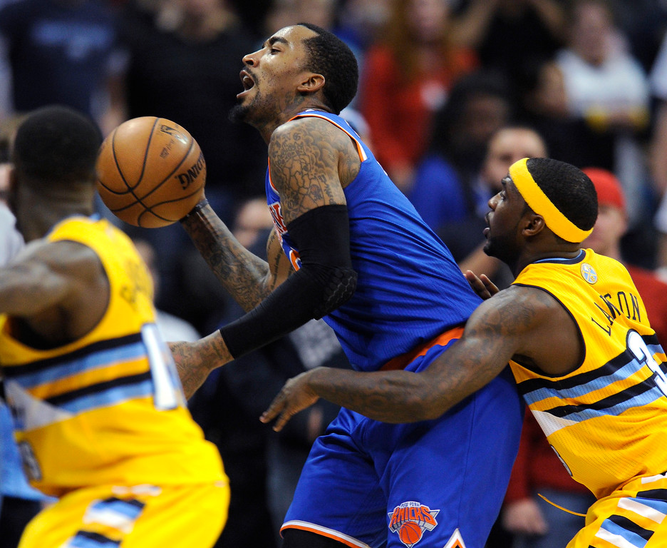 . New York guard J.R. Smith saved the ball from going out of bounds late in the fourth quarter.   Photo By Karl Gehring/The Denver Post