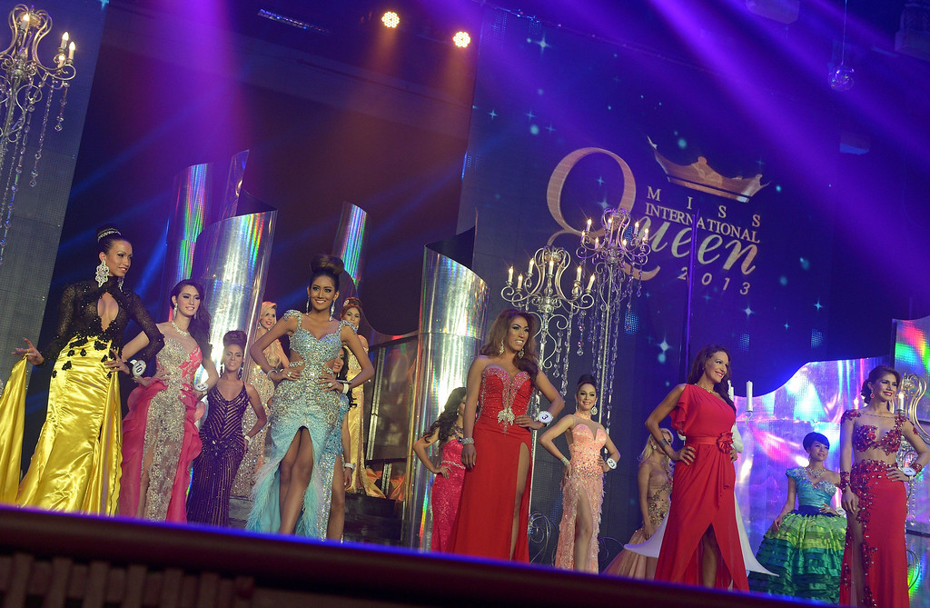 . Contestants pose during the International Queen 2013 Transexual beauty contest in Pattaya on November 1, 2013. Twenty-five contestants from 17 countries competed in Pattaya for the Miss International Queen title.        AFP PHOTO / PORNCHAI KITTIWONGSAKUL/AFP/Getty Images