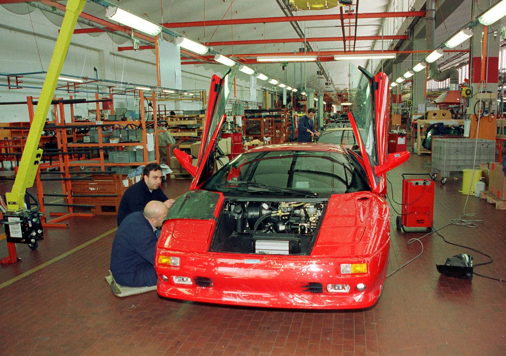 . A Lamborghini is assembled by workers in the Lamborghini automobile factory in Sant\'Agata Bolognese, near Bologna, in this filephoto taken May 5, 1998.  Volkswagen subsidiary Audi AG and Lamborghini SpA have signed a letter of intent that Audi will acquire the Italian sportscar maker, both companies announced on Friday June 12,1998. (AP Photo/Gianni Schicchi)