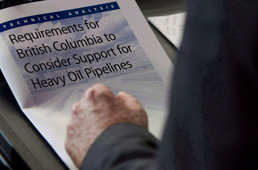 . The technical analysis and requirements for B.C. to consider support for heavy oil pipelines is seen as British Columbia Minister of Environment Terry Lake speaks about the Northern Gateway Project during a news conference in Vancouver, July, 23, 2012.  (AP Photo/The Canadian Press, Jonathan Hayward)