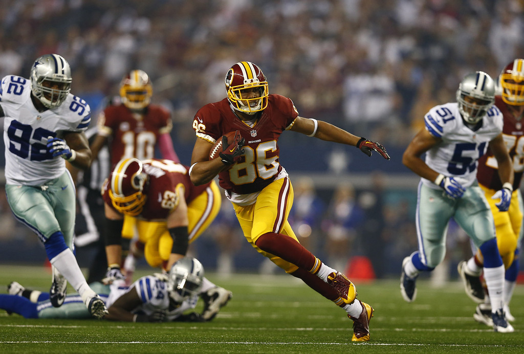 . Jordan Reed #86 of the Washington Redskins runs during a game against the Dallas Cowboys on October 13, 2013 in Arlington, Texas.  (Photo by Tom Pennington/Getty Images)