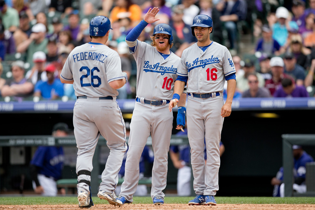 . DENVER, CO - JUNE 7:  Tim Federowicz #26 of the Los Angeles Dodgers is greeted at home plate by Justin Turner #10 and Andre Ethier #16 after hitting a three-run home run during the seventh inning against the Colorado Rockies at Coors Field on June 7, 2014 in Denver, Colorado. The Rockies defeated the Dodgers 5-4 in 10 innings to end their eight game losing streak. (Photo by Justin Edmonds/Getty Images)