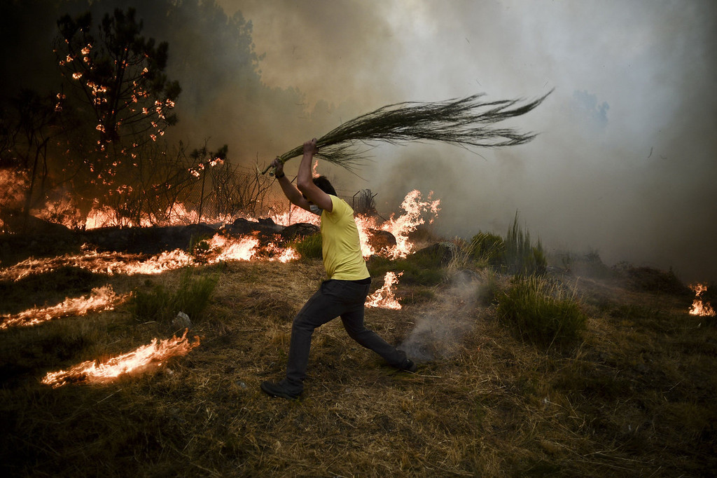 . A local tries to extinguish a wildfire in Caramulo, central Portugal on August 29, 2013. Five Portuguese mountain villages were evacuated overnight as forest fires intensified in the country\'s north and centre, officials said today. As many as 1,400 firefighters were dispatched Thursday to tackle the blaze in the mountains and another raging further north in the national park of Alvao, where 2,000 hectares (4,900 acres) of pine forest have already been destroyed, according to the local mayor.   PATRICIA DE MELO MOREIRA/AFP/Getty Images