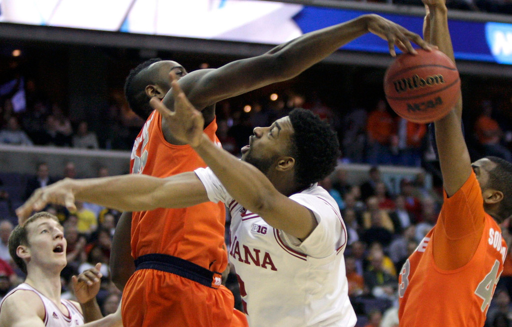 . Syracuse Orange forward Rakeem Christmas knocks the ball away from Indiana Hoosiers forward Christian Watford during the second half in their East Regional NCAA men\'s basketball game in Washington, March 28, 2013. REUTERS/Jonathan Ernst