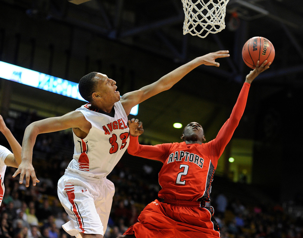 . BOULDER, CO. - MARCH 16: Raptors senior guard TreShawn Wilford (2) worked underneath Angels defender Tyre Robinson (32) in the first half. The Denver East High School boy\'s basketball team met Eaglecrest in the 5A championship game Saturday, March 16, 2013 at the Coors Events Center in Boulder.  (Photo By Karl Gehring/The Denver Post)