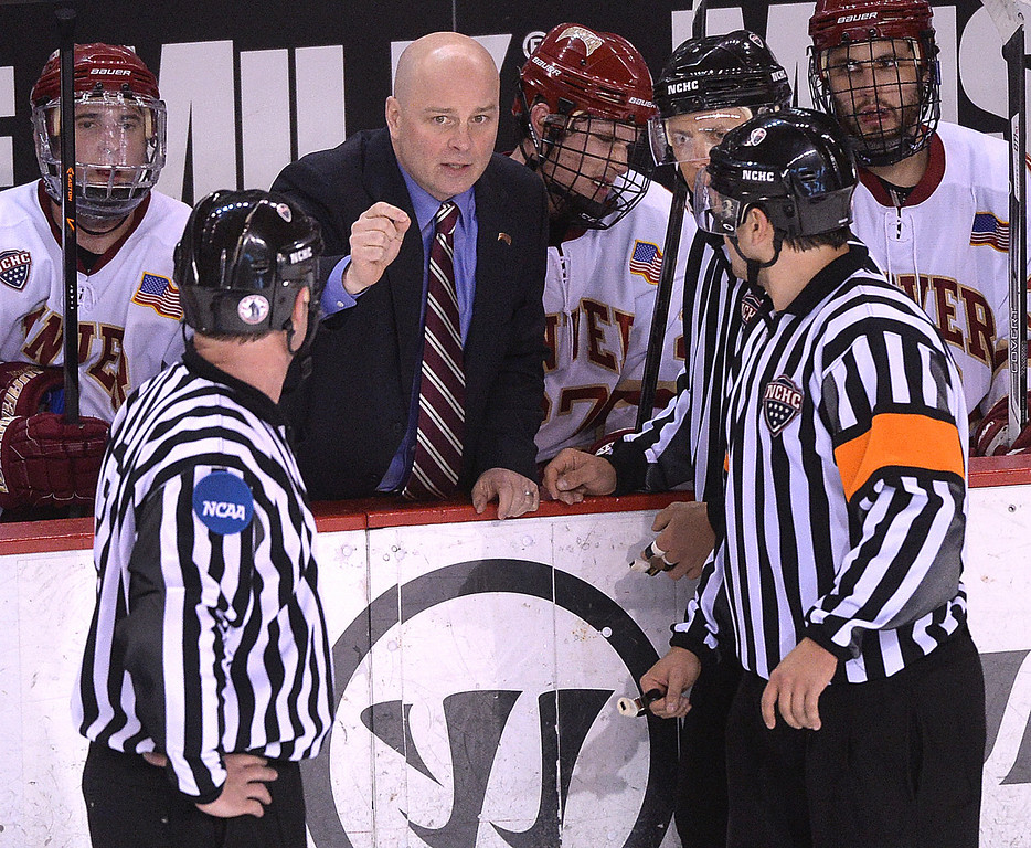 . DENVER, CO. - FEBRUARY 21, 2014: Denver coach Jim Montgomery talked to the officials in the third period. The Colorado College hockey team defeated Denver 3-2 at Magness Arena Friday night, February 21, 2014. Photo By Karl Gehring/The Denver Post