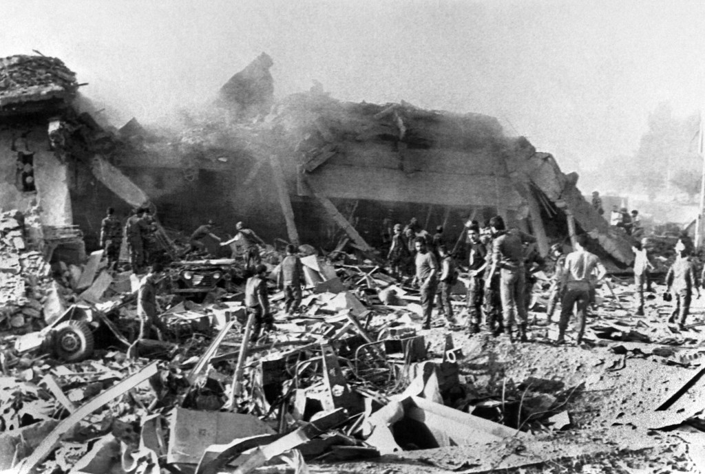 . US Marines search on October 23, 1983, through tons of rubble for their missing comrades in the devastation of the Marines Headquarters in the southern suburbs of Beirut, which was destroyed by a suicide bomber driving a truck packed with explosives. 299 Marines were killed in the blast. The troops were part of the FMSB, (Beirut security multinational force) that was installed to keep security in the Lebanese capital. The Beirut barracks bombing on October 23, 1983 in Beirut occurred during the Lebanese Civil War, two truck bombs struck separate buildings housing United States and French military forces?members of the Multinational Force in Lebanon?killing 299 American and 58 French paratroopers. The organization Islamic Jihad claimed responsibility for the bombing. (PIERRE SABBAGH/AFP/Getty Images)