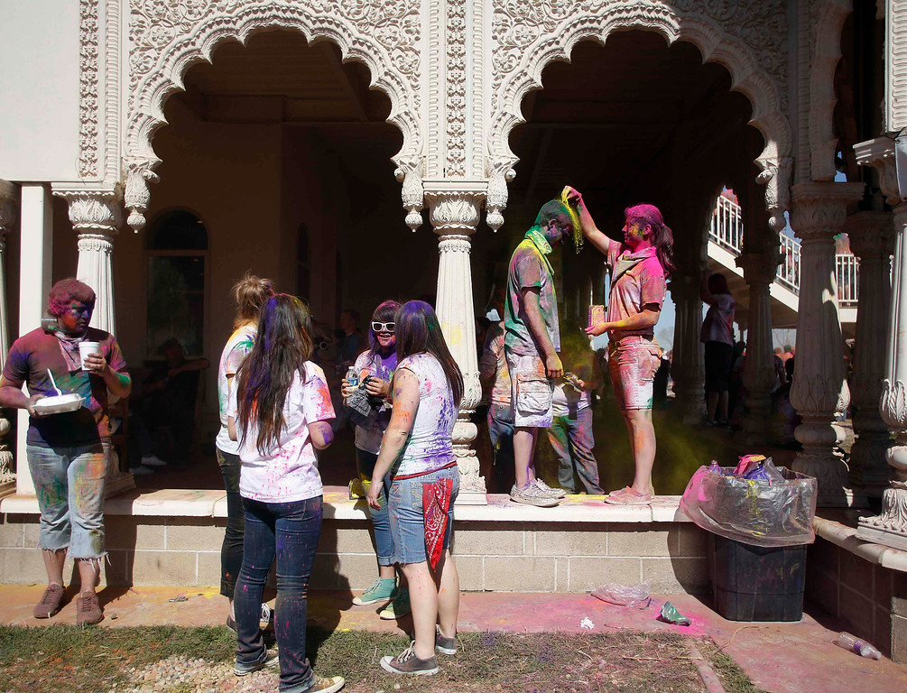 . Participants take a break during the Holi Festival of Colors at the Sri Sri Radha Krishna Temple in Spanish Fork, Utah, March 30, 2013.  REUTERS/Jim Urquhart