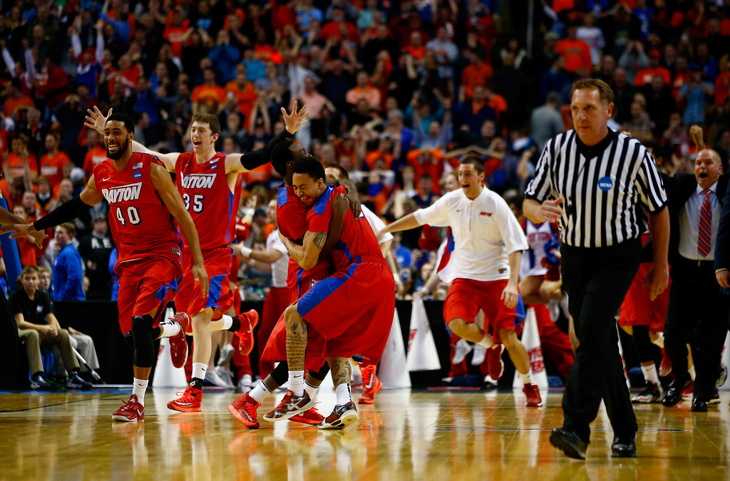 . BUFFALO, NY - MARCH 22:  The Dayton Flyers celebrate after defeating the Syracuse Orange 55-53 in the third round of the 2014 NCAA Men\'s Basketball Tournament at the First Niagara Center on March 22, 2014 in Buffalo, New York.  (Photo by Jared Wickerham/Getty Images)