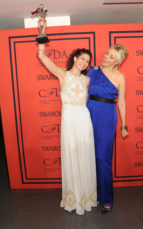 . Winner of the Swarovski Accessories Designer of the Year, Pamela Love (R) poses with Nadja Swarovski at the 2013 CFDA Fashion Awards at Alice Tully Hall on June 3, 2013 in New York City.  (Photo by Jamie McCarthy/Getty Images)