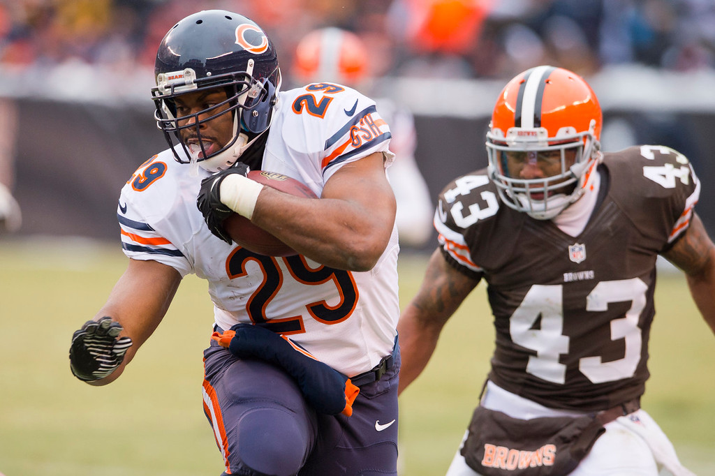 . Running back Michael Bush #29 of the Chicago Bears is pursued by strong safety T.J. Ward #43 of the Cleveland Browns  during the second half at FirstEnergy Stadium on December 15, 2013 in Cleveland, Ohio. The Bears defeated the Browns 38-31. (Photo by Jason Miller/Getty Images)