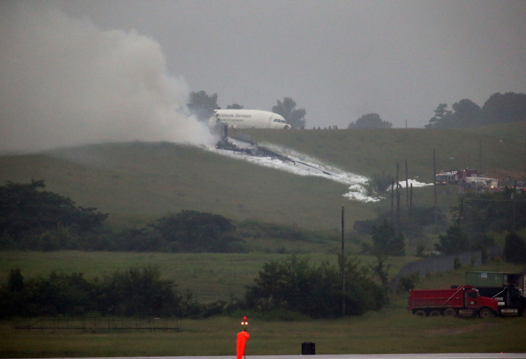 . A UPS cargo plane lies on a hill at Birmingham-Shuttlesworth International Airport after crashing on approach, Wednesday, Aug. 14,  2013, in Birmingham, Ala. (AP Photo/Hal Yeager)