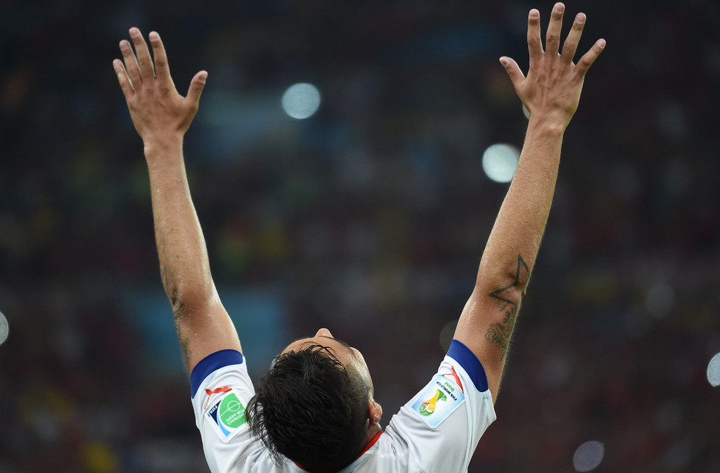 . A chile player reacts after the Group B football match between Spain and Chile in the Maracana Stadium in Rio de Janeiro during the 2014 FIFA World Cup on June 18, 2014.  CHRISTOPHE SIMON/AFP/Getty Images