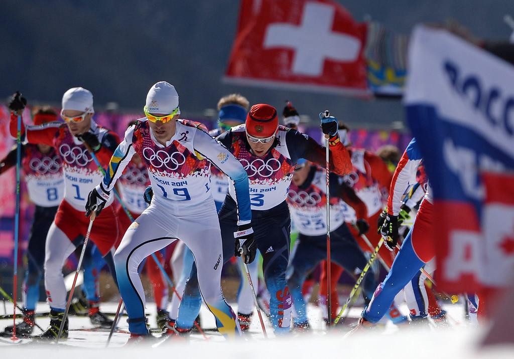 . Alexander Legkov of Russia (C) in action during the Men\'s 50km Mass Start Free Cross Country Skiing event at the Laura Cross-Country Center during the Sochi 2014 Olympic Games, Krasnaya Polyana, Russia.  EPA/HENDRIK SCHMIDT