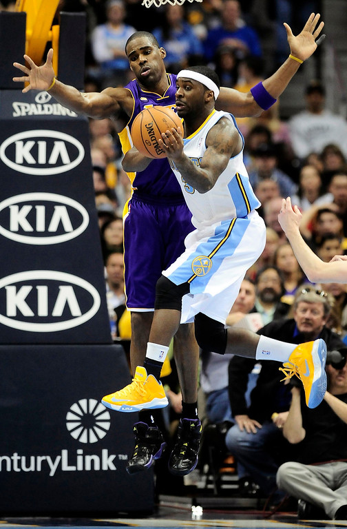 . Los Angeles Lakers\' Antawn Jamison (L) forces Denver Nuggets\' Ty Lawson to pass the ball during their NBA basketball game in Denver, Colorado February 25, 2013.   REUTERS/Mark Leffingwell