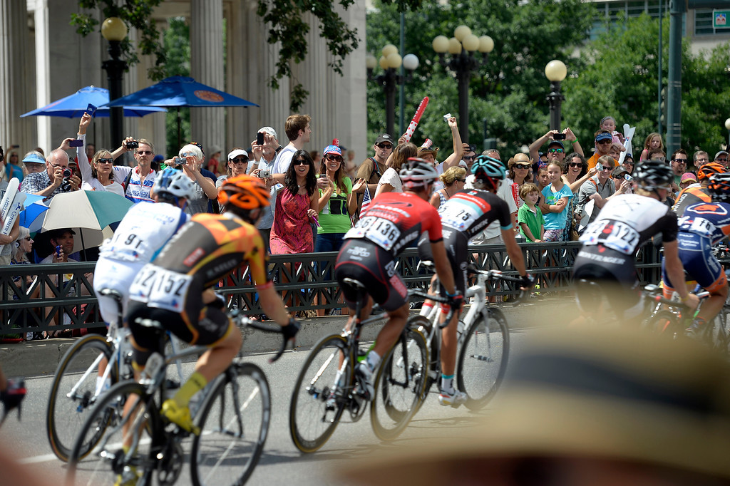 . Fans cheer on the riders as they pass near Civic Center Park. This was the final stage in the USA Pro Cycle Challenge as it makes it way through downtown Denver August 25, 2013. Aspen\'s Tejay van Garderen won the 3rd annual Pro Cycle Challenge. (Photo by John Leyba/The Denver Post)