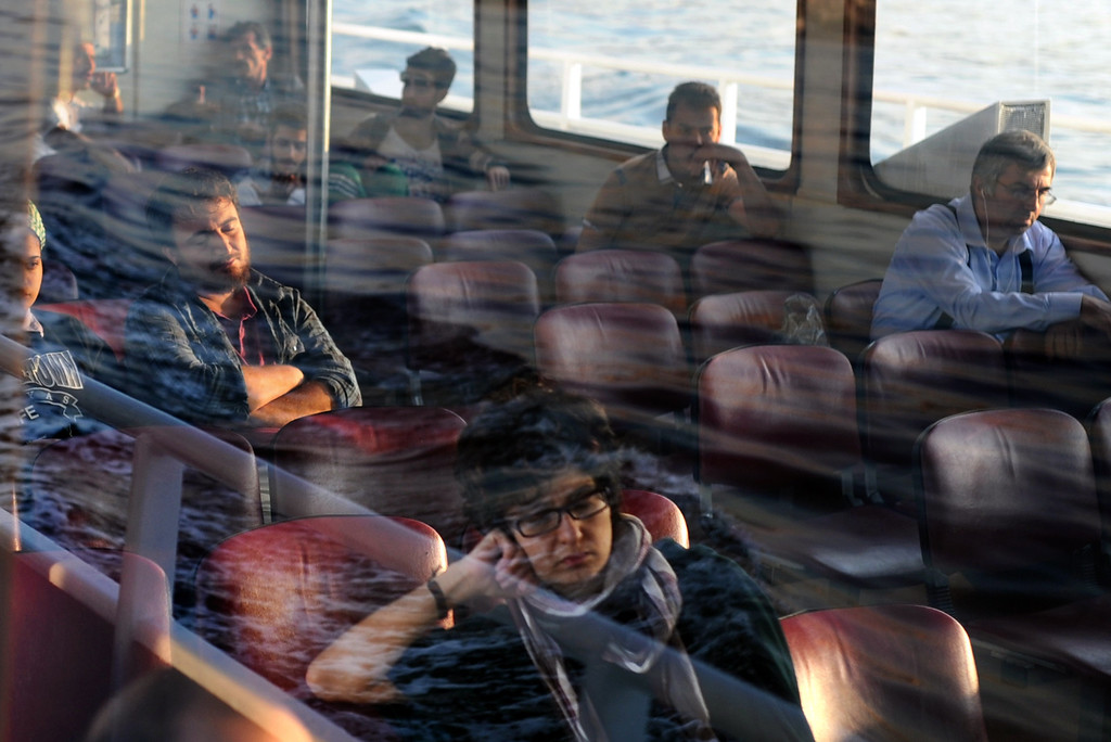 . Turkish passengers travel by ferry on the Bosphorus from the European side to Asian side of Istanbul on June 6, 2013. Prime Minister Recep Tayyip Erdogan was due back in Turkey today after a trip abroad, with thousands of angry demonstrators calling for his resignation as protests entered a seventh day. BULENT KILIC/AFP/Getty Images