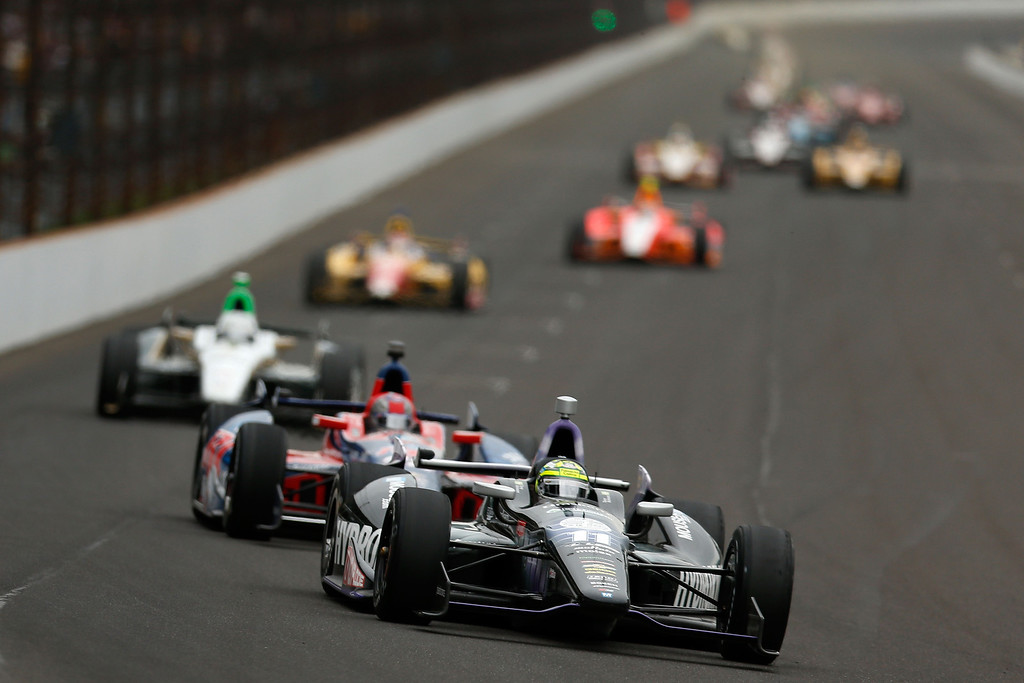 . Tony Kanaan of Brazil, driver of the Hydroxycut KV Racing Technology-SH Racing Chevrolet, leads a pack of cars during the IZOD IndyCar Series 97th running of the Indianapolis 500 mile race at the Indianapolis Motor Speedway on May 26, 2013 in Indianapolis, Indiana.  (Photo by Chris Graythen/Getty Images)