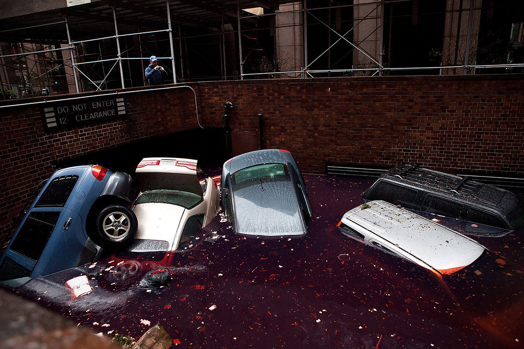. Cars floating in a flooded basement following Hurricane Sandy on October 30, 2012 in the Financial District of New York, United States. The storm has claimed at least 33 lives in the United States, and has caused massive flooding across much of the Atlantic seaboard. US President Barack Obama has declared the situation a \'major disaster\' for large areas of the US East Coast including New York City. (Photo by Andrew Burton/Getty Images)