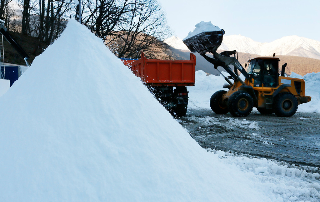 . A wheel loader transports artificial snow to prepare the cross country tracks for the Nordic Combined prior to the 2014 Winter Olympics, Tuesday, Feb. 4, 2014, in Krasnaya Polyana, Russia. (AP Photo/Dmitry Lovetsky)