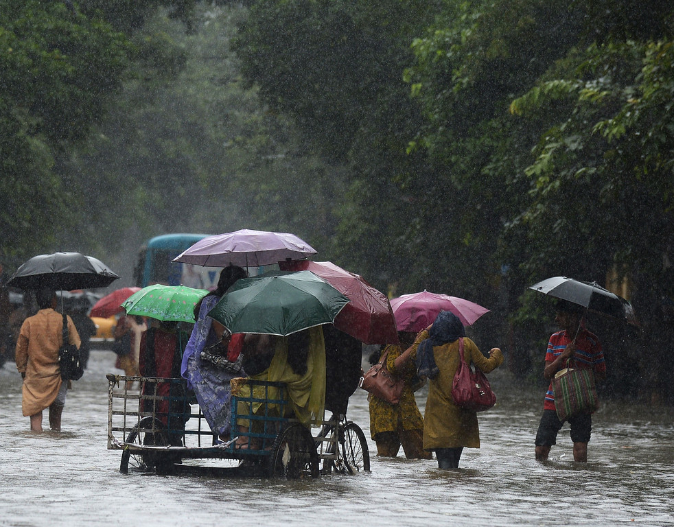 . An Indian rickshaw puller carries students through water-logged streets in Kolkata on October 26, 2013.  Persistent rain for the last 24 hours has thrown normal life out of gear with reports of water logging at major arterial roads of the city which received 14 cm rainfall, the highest rainfall during the ongoing depression in eastern India. DIBYANGSHU SARKAR/AFP/Getty Images