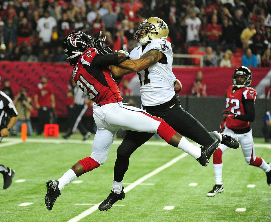 . Desmond Trufant #21 of the Atlanta Falcons breaks up a pass intended for Robert Meachem #17 of the New Orleans Saints at the Georgia Dome on November 21, 2013 in Atlanta, Georgia. (Photo by Scott Cunningham/Getty Images)