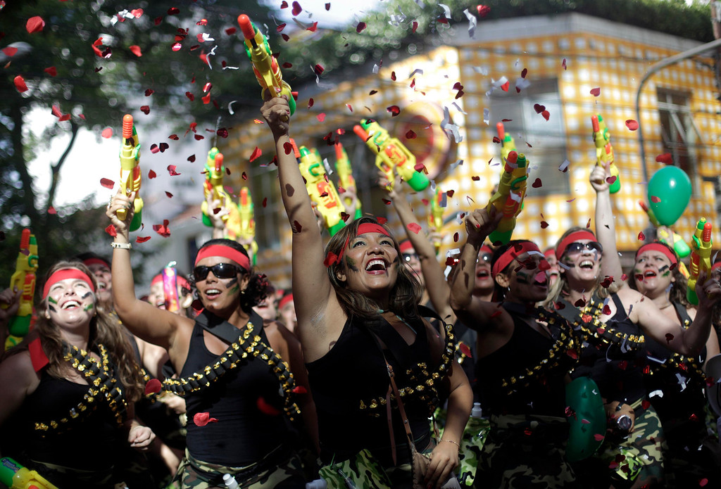 ". Revellers dance during the annual block party known as the ""Suvaco do Cristo\"" (Armpit of Christ), one of the many pre-carnival parties to take place in the neighborhoods of Rio de Janeiro February 3, 2013. REUTERS/ Ricardo Moraes"