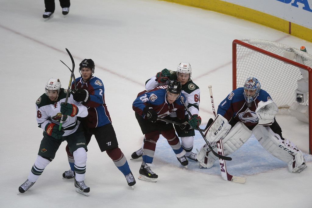 . Matt Moulson (26) of the Minnesota Wild, Nick Holden (2) and Paul Stastny (26) of the Colorado Avalanche, Mikael Granlund (64) of the Minnesota Wild and Semyon Varlamov (1) of the Colorado Avalanche look for an incoming puck during the first period of action. (Photo by Karl Gehring/The Denver Post)