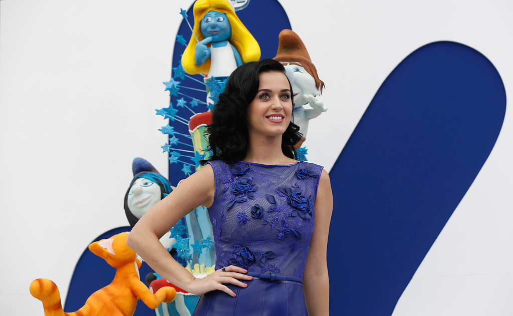 """. Singer Katy Perry, who voiced the character of \""""Smurfette\"""", poses at the premiere of \""""The Smurfs 2\"""" at the Regency Village theatre in Los Angeles, California July 28, 2013. The movie opens in the U.S. on July 31.  REUTERS/Mario Anzuoni"""