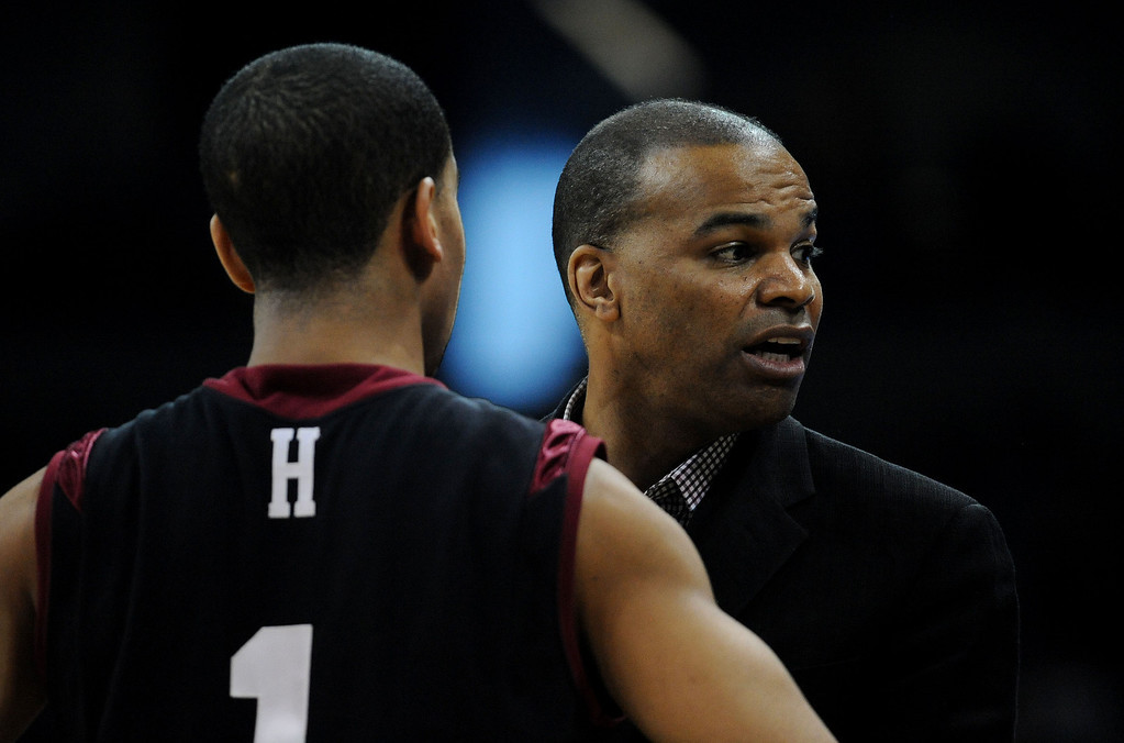 . SPOKANE, WA - MARCH 22:  Head coach Tommy Amaker talks to Siyani Chambers #1 of the Harvard Crimson in the first half against the Michigan State Spartans during the Third Round of the 2014 NCAA Basketball Tournament at Spokane Veterans Memorial Arena on March 22, 2014 in Spokane, Washington.  (Photo by Steve Dykes/Getty Images)