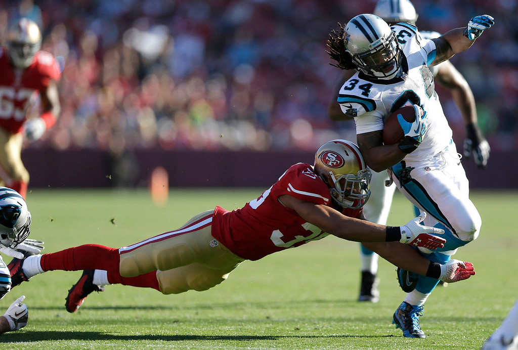 . Carolina Panthers running back DeAngelo Williams (34) runs past San Francisco 49ers safety Eric Reid (35) to score on a 27-yard touchdown run during the second quarter of an NFL football game in San Francisco, Sunday, Nov. 10, 2013. (AP Photo/Marcio Jose Sanchez)
