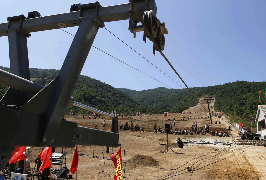 """. North Korean soldiers work on at building project to construct a ski resort at North Korea\'s Masik Pass on Aug. 23, 2013. North Korean authorities have been encouraging a broader interest in sports in the country, both at the elite and recreational levels, as a means of energizing and mobilizing the masses, which North Korea\'s slogan spinners are calling \""""the hot wind of sports blowing through Korea.\"""" (AP Photo/Kim Kwang Hyon)"""