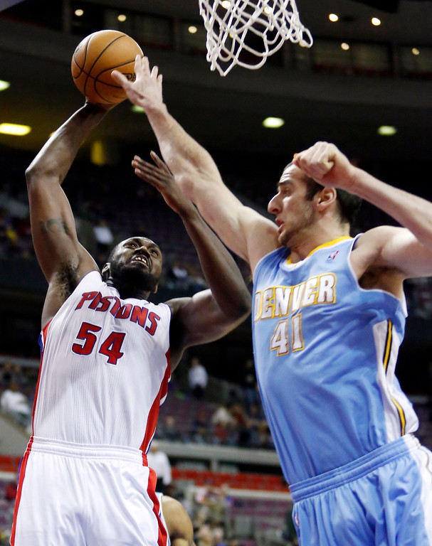 . Detroit Pistons forward Jason Maxiell (54) shoots against Denver Nuggets center Kosta Koufos (41) in the first half of an NBA basketball game, Tuesday, Dec. 11, 2012, in Auburn Hills, Mich. (AP Photo/Duane Burleson)