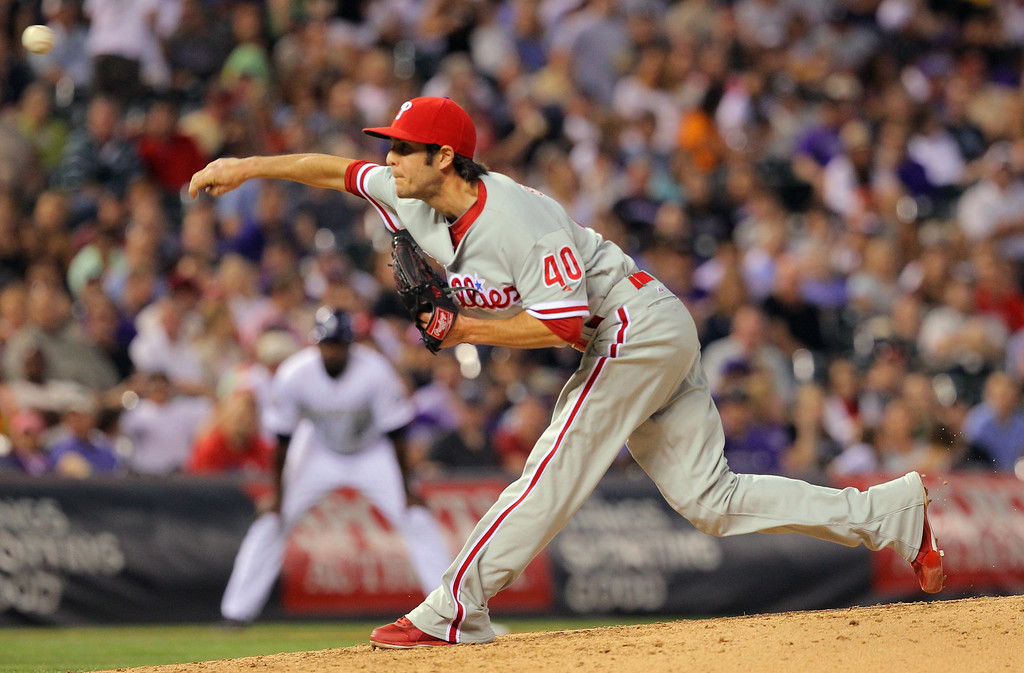 . DENVER, CO - JUNE 14:  Relief pitcher Michael Stutes #40 of the Philadelphia Phillies delivers against the Colorado Rockies at Coors Field on June 14, 2013 in Denver, Colorado. Stutes earned the win as the Phillies defeated the Rockies 8-7.  (Photo by Doug Pensinger/Getty Images)