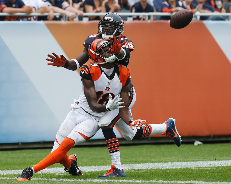 . Cincinnati Bengals wide receiver A.J. Green (18) misses a pass reception in the end zone against Chicago Bears cornerback Charles Tillman (33) during the second half of an NFL football game, Sunday, Sept. 8, 2013, in Chicago. Tillman was called for pass interference on the play. (AP Photo/Charles Rex Arbogast)