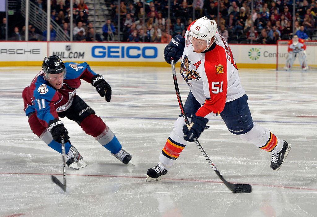 . Florida Panthers defenseman Brian Campbell (51) shoots a goal against Colorado Avalanche left wing Jamie McGinn (11) during the second period of an NHL hockey game, on Saturday, Nov. 16, 2013, in Denver. (AP Photo/Jack Dempsey)