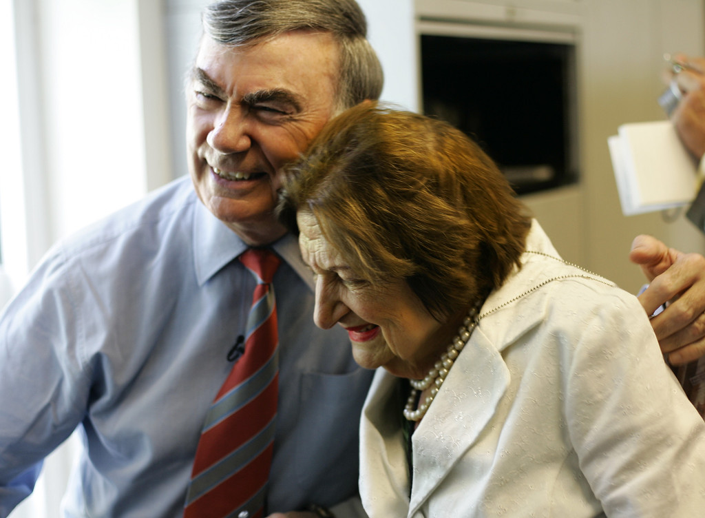 . Former ABC News correspondent Sam Donaldson, left, smiles as he embraces veteran White House reporter Helen Thomas during a farewell to the cramped and worn White House press briefing room that is being closed for renovations, in Washington, Wednesday, Aug. 2, 2006. The current briefing room dates to the 1970\'s, when Richard Nixon ordered an indoor swimming pool covered over. But seats are broken, walls are crumbling and the air conditioning\'s long overdue for replacement. (AP Photo/J. Scott Applewhite)