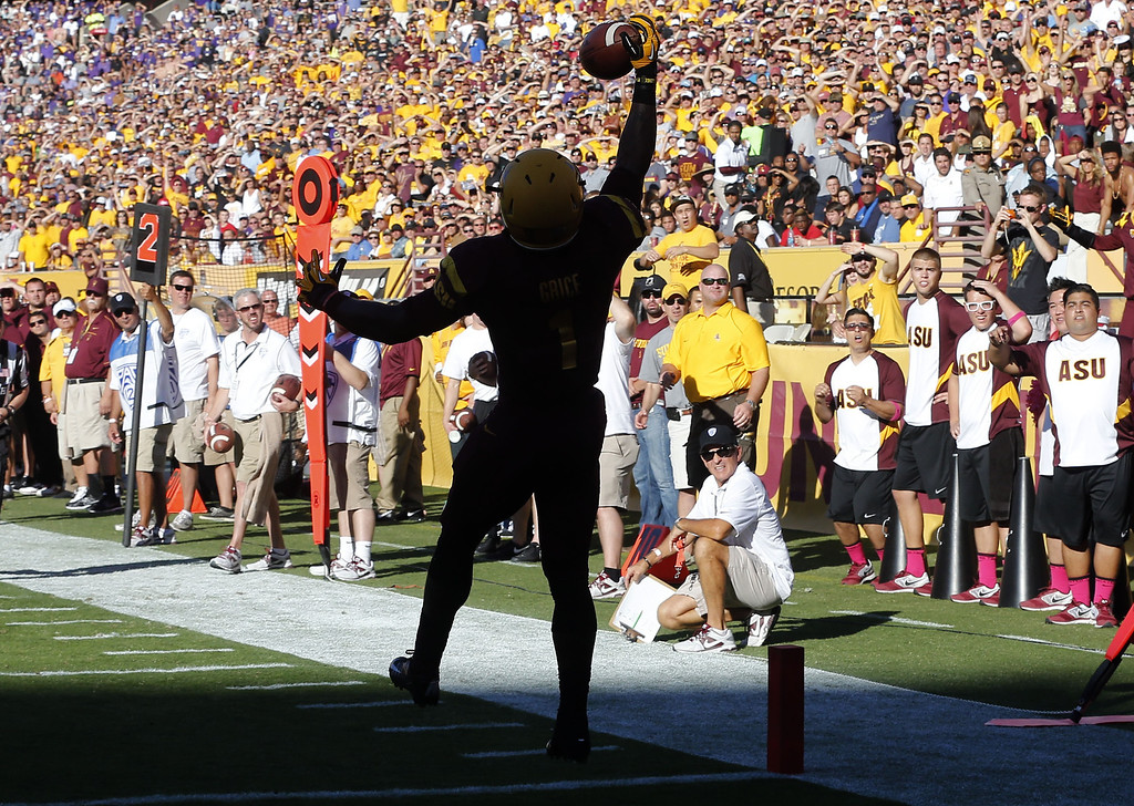 . Arizona State running back Marion Grice pulls in a touchdown against Washington during the first of an NCAA college football game, Saturday, Oct. 19, 2013, in Tempe, Ariz. (AP Photo/Matt York)